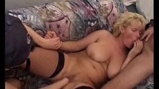 MILF In Titillating Fishnets Double Teamed