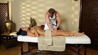 Busty beauty throatfucked by lucky masseur