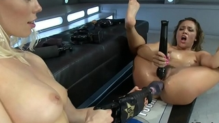 Lesbian babes upside down for dildo machine
